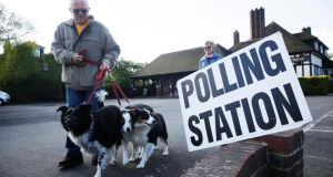 A UK voter with his dogs outside a local polling station. The hashtag #Dogsatpollingstations, where voters shared pictures of their dogs accompanying them to vote,  proved to be one of the most striking trends of the election. Photograph: Matthew Lloyd/Bloomberg