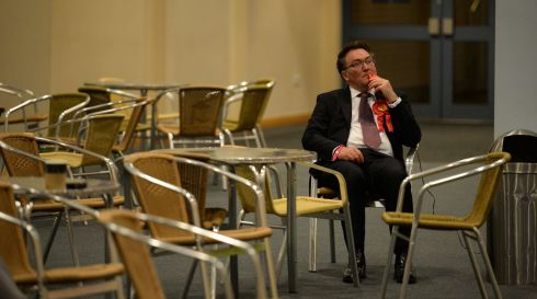 A Labour Party activist watches the results come in at the counting centre at Doncaster Racecourse, northern England. Photograph: OLI SCARFF/AFP/Getty Images