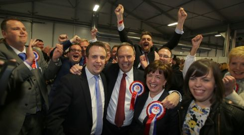 Nigel Dodds (centre), deputy leader of the Democratic Unionist Party celebrates taking the Belfast North seat at the election count at the Kings Hall in Belfast. Photograph: PAUL FAITH/AFP/Getty Images