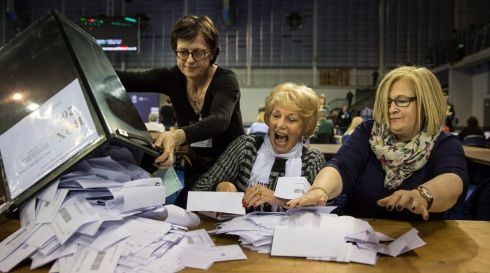 Officials are given ballot papers ready to be counted, at Emirates Arena in Glasgow, Scotland. Photograph: EPA/ROBERT PERRY