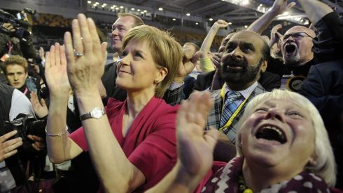 Leader of the SNP, Nicola Sturgeon (left) applauds as she listens to results at the Glasgow election count. Photograph: Andy Buchanan/AFP/Getty Images