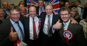 DUP Leader Peter Robinson celebrates with MPs (left to right) Sammy Wilson, Nigel Dodds, Gavin Robinson and Jeffrey Donaldson their General Election results at the Kings Hall in Belfast. Photograph: Niall Carson/PA Wire