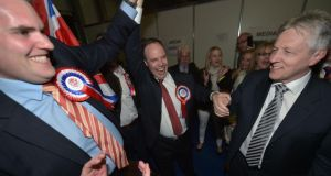 Nigel Dodds (centre) celebrates with DUP leader Peter Robinson (right) and Gavin Robinson (left). Photograph: Charles McQuillan/Getty Images