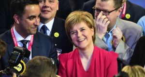 Nicola Sturgeon celebrates a stunning SNP performance  in Glasgow, Scotland. The SNP has won at least 55 of the 59 seats in Scotland.