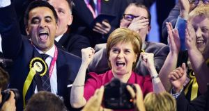 SNP leader Nicola Sturgeon celebrates in Glasgow as her party secured 56 out of the 59 seats in Scotland. Photograph: Getty