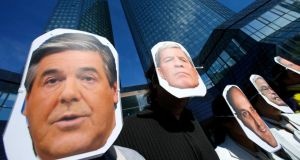 Protesters outside Deutsche Bank's headquarters in Frankfurt recently wearing masks depicting former chief executive Josef Ackermann, co-chief executive Juergen Fitschen, former board member Tessen von Heydebreck and former chief executive Rolf Breuer. Photograph: Ralph Orlowski/Reuters