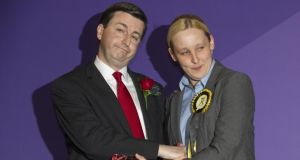 Newly elected SNP member of parliament Mhairi Black greets defeated Labour MP Douglas Alexander. Photograph: Lesley Martin/AFP/Getty Images