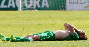 Jonathan Lunney cuts a dejected figure after Ireland's 2-0 defeat to Italy. Photograph: Kostadin Andonov/Inpho