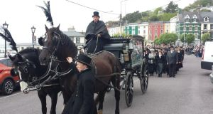 A horsedrawn hearse in Cobh at the commemoration of the sinking of the Lusitania. Photograph: Barry Roche