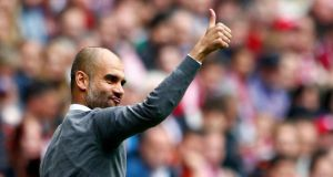 After the 2013 treble Pep Guardiola's challenge was no longer to take Bayern to the next level, but to maintain the standards set by his suddenly illustrious predecessor. Photograph: Michaela Rehle/Reuters.
