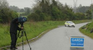 Garda preserve the scene on Steelstown Road in Rathcoole, Co Dublin after a baby girl was discovered by a member of the public on Friday. Photograph: Stephen Collins/Collins Photos.
