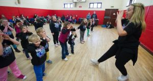 Dance instructor Niamh Mullarkey with  Fit Kids Fit Teens in Mell Parish Hall, Drogheda, Co Louth. Photograph: Barry Cronin