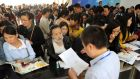 People line up to apply for teaching jobs at the local education bureau, in Lianyungang, Jiangsu province, China recently. Photograph:  Reuters/China Daily