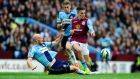 Aston Villa's Jack Grealish is challenged by James Collins of West Ham during the Premier League match at Villa Park. Photo: Stu Forster