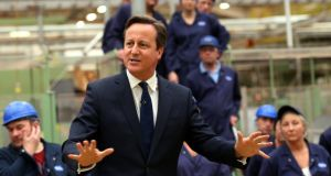 "British prime minister David Cameron talks to staff during a visit to the Tetley factory in Stockton-on-Tees. Mr Cameron told workers that it is ""almost impossible to get a decent cup of tea in Europe"". Photograph: PA"