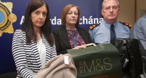 Garda Sergeant Maeve O'Sullivan, Rita Byrne principal social worker with Tusla and Superintendent Brendan Connolly showing items similar to those found with the newborn baby girl discovered in Rathcoole, Co Dublin on Friday. Photograph: Gareth Chaney Collins