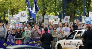 Protesters, many against the so-called fast track trade authority of the TTP trade agreement, rally outside a hotel where US President Barack Obama held a meeting in Portland, Oregon last week. REUTERS/Jonathan Ernst