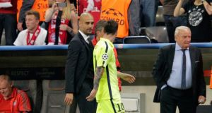Pep Guardiola speaks to Lionel Messi at half-time during the Champions League semi-final at the Allianz Arena. Photo: Adam Pretty/Bongarts/Getty Images