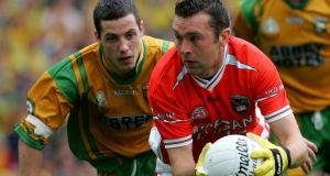 Saving grace: Oisín McConville playing for Armagh in the 2006 Ulster final at Croke Park, against Donegal. Photograph: Bryan O'Brien