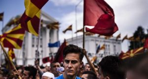 Anti-government protesters  wave Macedonian and Albanian flags  in Skopje. Photograph:   Dimitar Dilkoff/AFP/Getty