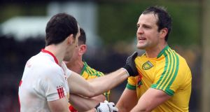 Donegal's Michael Murphy and Tyrone's Ronan McNabb exchange words during the Ulster senior championship match at Ballybofey, Donegal. Photograph: Inpho