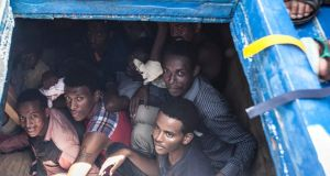 Migrants  inside the  hull of their wooden boat off the coast of Libya:  Medecins sans Frontieres (MSF) and Moas (Migrant Offshore Aid Station) rescued 561 migrants on Thursday May 14th. Photograph: Jason Florio/Moas/Reuters