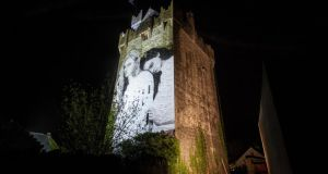 A new referendum mural by artist Joe Caslin, who also created the mural on St Gt George's Street, has been installed on a 15th-century castle near Craughwell, Co Galway. Photograph: David Sexton