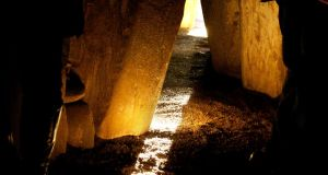 The sun shines along the passage floor into the inner chamber at Newgrange during the winter solstice. Photograph: Alan Betson/The Irish Times