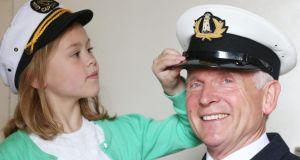 Sarah Phelan (6) with Lighthouse Keeper Gerald Butler from Galley Head lighthouse in The National Maritime Museum of Ireland Dún Laoghaire. Photograph: Leon Farrell/Photocall Ireland