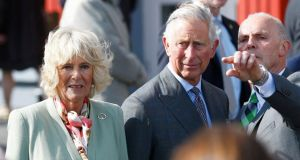 Prince Charles and his wife Camilla Parker Bowles visit the village of Mullaghmore on Wednesday. Photograph:  Darren Staples/Reuters