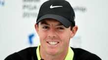 Thriving on the intimidation factor: Rory McIlroy holds press court at Wentworth on Wednesday. Photograph: Adam Davy/PA