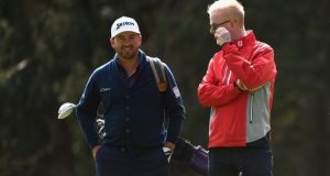 Broadcaster Chris Evans talks to Graeme McDowell  during the Pro-Am ahead of the BMW PGA Championship at Wentworth.  Photograph: Ross Kinnaird/Getty Images