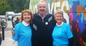 Bus driver Andy Wilkinson with Moninne Griffith(left) and Mary McDermott of the Yes Equality campaign