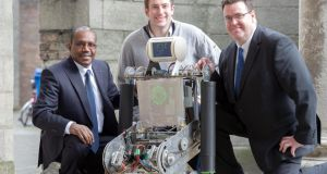 Robbie the Robot, an assistance robot for those born without limbs, with Dr Hamadoun I. Touré of the UN and TCD's Conor McGinn and Kevin Kelly