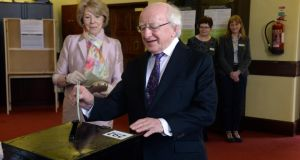 President Michael D Higgins and his wife Sabina voting at Mary's Hospital polling station this morning. Photograph: Cyril Byrne /The Irish Times