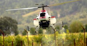 Yamaha's unmanned helicopter used for crop spraying