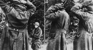 Total war: German soldiers taken prisoner by American forces during the Battle of the Bulge. Photograph: Office of War Information/US National Archives/Time Life/Getty
