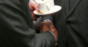 Heavily symbolic: Pince Charles holds a cup of tea as he shakes hands with Sinn Féin party leader Gerry Adams. Photograph: Brian Lawless/Reuters