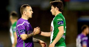Shamrock Rovers' Gary McCabe and John Kavanagh of Cork City after the scoreless game at Turner's Cross. Photograph: James Crombie/Inpho.
