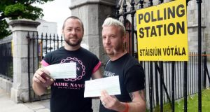Micheal Baron (left) founder of Belong with his husband Jamie Nanci at North Strand polling station. Photograph: Cyril Byrne / THE IRISH TIMES