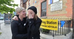 Sarah Francis and Una Mullally after voting  on  Pearse street in Dublin on Friday. Photograph: Alan Betson