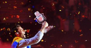 Singer Mans Zelmerloew representing Sweden poses with the trophy after winning the final of the 60th annual Eurovision Song Contest in Vienna. Photograph: Heinz-Peter Bader/Reuters.
