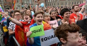 Crowds react in the courtyard of Dublin Castle on hearing the results of the same-sex marriage referendum. Photograph: Dara Mac Dónaill/The Irish Times.