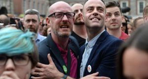 Dave Power, Mount Merrion and Paul Byrne, Swords in the courtyard of Dublin castle as the same-sex marriage referendum results are announced on Saturday. Photograph: Dara Mac Dónaill/The Irish Times.
