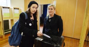 Una Mullally with her partner Sarah Francis voting in the marriage referendum in Pearse Street, Dublin. Photograph: Alan Betson