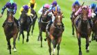 Gleneagles ridden by Ryan Moore (Blue and Orange cap) win the Tattersalls Irish 2,000 Guineas  at The Curragh. Photograph: Pat Healey/PA Wire