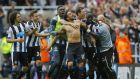 Jonas Gutierrez is mobbed by his  teammates after his goal virtually guaranteed Newcastle's Premier League survival. Photograph: Reuters
