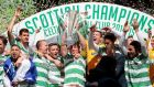 Celtic players celebrate  as Scott Brown lifts the  Scottish Premiership trophy. Photograph:  Graham Stuart/Reuters