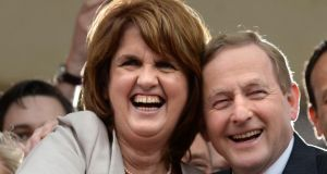 Tánaiste Joan Burton and Taoiseach Enda Kenny in the courtyard at Dublin Castle for the results of the referendum on marriage equality. Photograph: Dara Mac Dónaill/The Irish Times