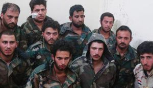 This picture released today by a militant website which had been verified shows Syrian government soldiers captured by Islamic State militants in the Palmyra area  of Syria. Photograph: militant website via AP